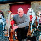 Andy Tynan at his home in Keenagh, Co Longford, with a selection of his rocking horses. Photograph: James Flynn/APX