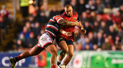 17 December 2016; Simon Zebo of Munster is tackled by Manu Tuilagi of Leicester Tigers during the European Rugby Champions Cup Pool 1 Round 4 match between Leicester Tigers and Munster at Welford Road Stadium, Leicester. Photo by Diarmuid Greene/Sportsfile