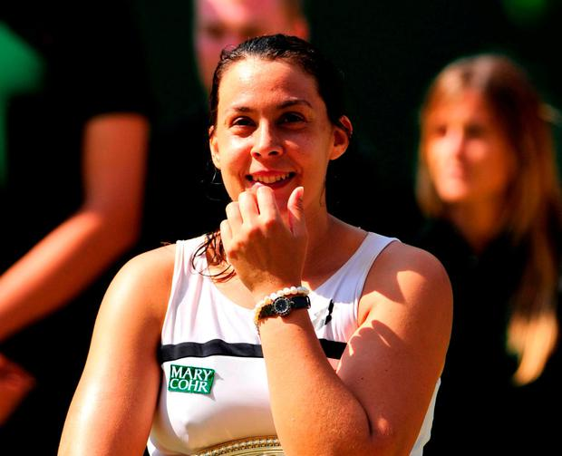 The 2013 Wimbledon champion Marion Bartoli. Photo: Glyn Kirk/AFP/Getty Images