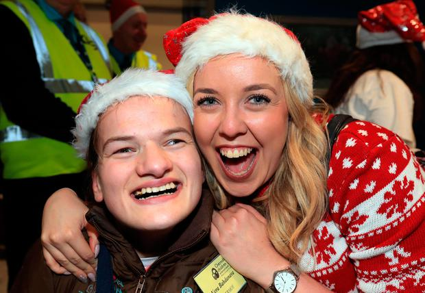 Vera Bahdanava, from Belarus, is greeted by Lorna White, from Malahide, Co Dublin, as she arrived with 29 others at Dublin Airport in a trip organised by the Chernobyl Children International charity. Photo: Colin Keegan