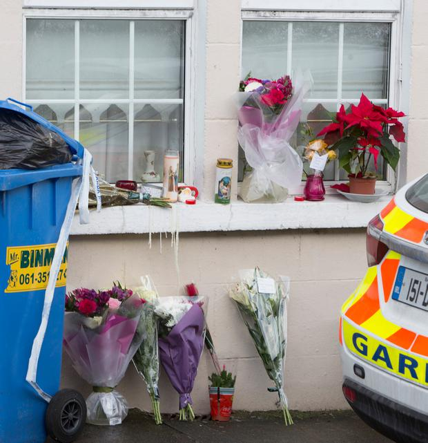 Flowers and candles at the house of the late Rosie Hanrahan in Limerick. Photo: Liam Burke