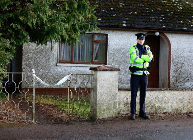 A garda outside the home of Joseph Waters in Kildangan, Co Offaly