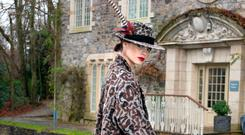 'Dusko' animal- print hat with feather, €275, Anthony Peto, 14 South Anne Street, Dublin2. Masai animal print wool coat, €320; Marella cream culottes, €139; Gerard Darel bag, €340; Fitzpatricks suede ankle boots, €199, all from Arnotts. Photo: Tony Gavin