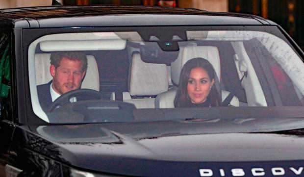 Prince Harry and Meghan Markle arriving for the Queen's Christmas lunch at Buckingham Palace, London