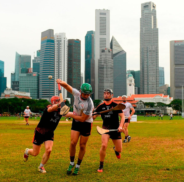 Conor Whelan in action against James Barry and Pauric Mahony at the Singapore Recreation Club during the All Stars' visit earlier this month. Photo: Ray McManus/Sportsfile