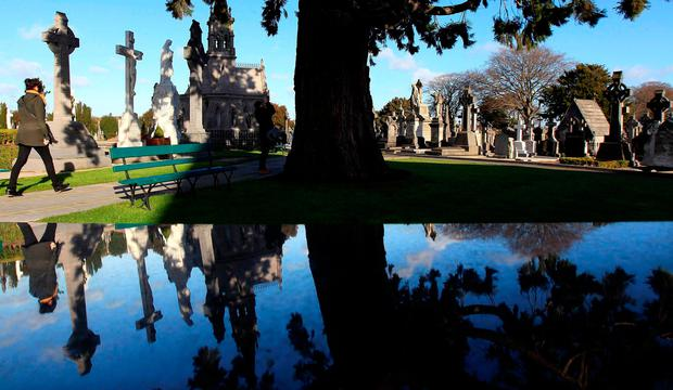Memorials and gravestones are seen reflected on a sculpture at Glasnevin Cemetery in Dublin. Photo: REUTERS