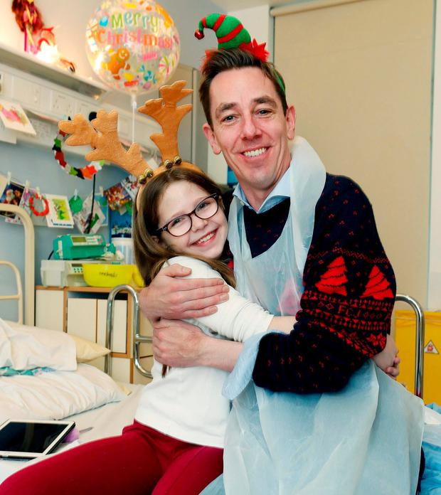Ryan Tubridy meets Beth Byrne (9), from Old Bawn, Co Dublin, as he visited Crumlin Children's Hospital as part of the Children's Medical & Research Foundation. Photo: Robbie Reynolds