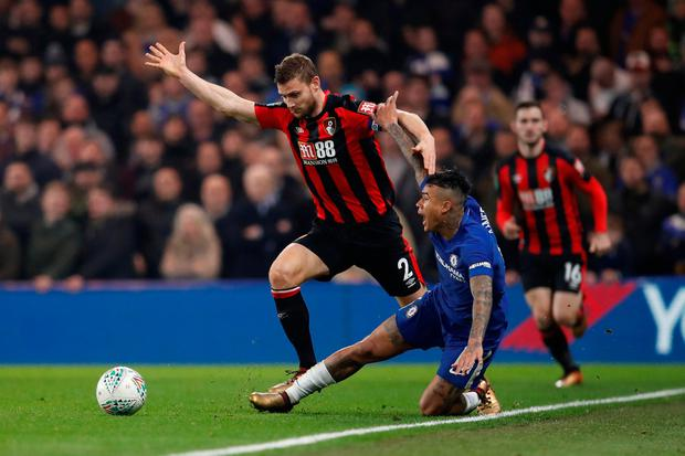 Bournemouth's Simon Francis battles with with Chelsea's Kenedy. Photo: Eddie Keogh/Reuters