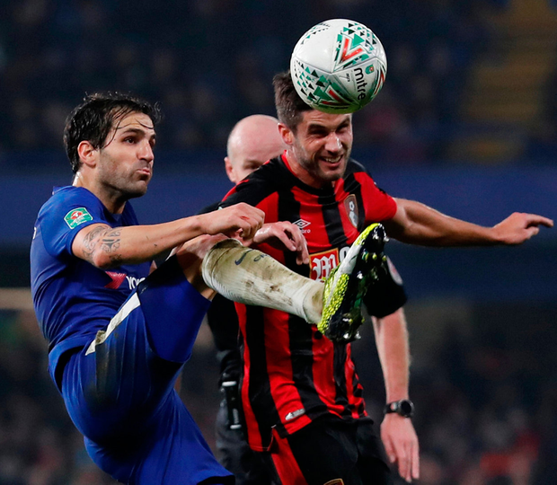 Chelsea's Cesc Fabregas in action with Bournemouth's Andrew Surman at Stamford Bridge. Photo: Eddie Keogh/Reuters