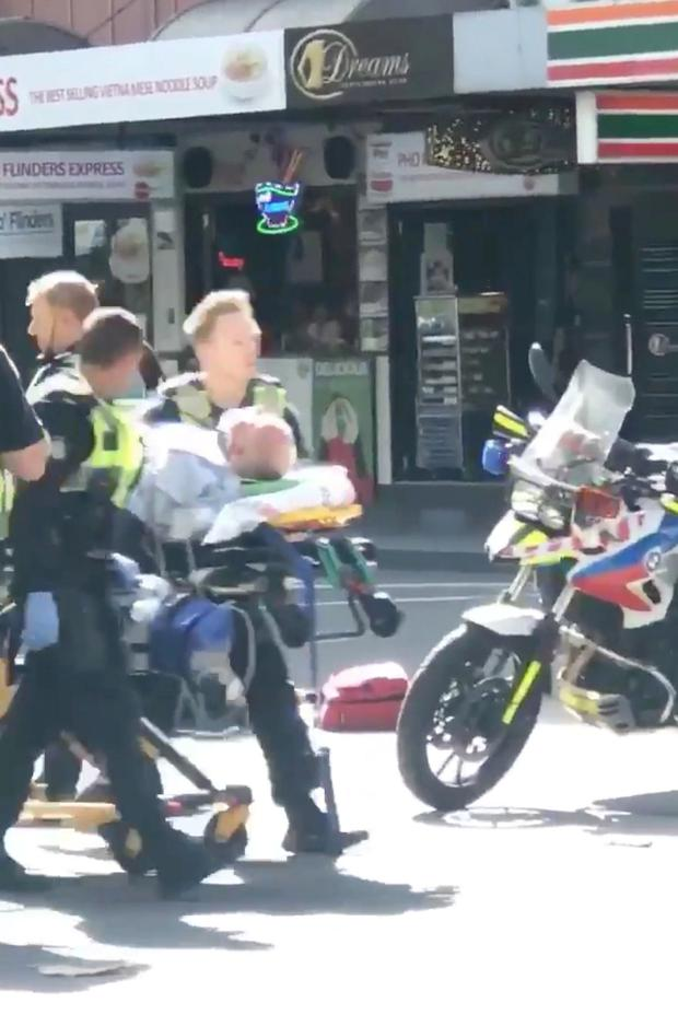 Emergency services attend to injured people at the in Flinders St station in Melbourne, Australia
