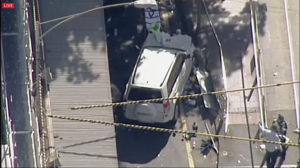 Local media say over a dozen people have been injured after a car drove into pedestrians on a sidewalk in central Melbourne