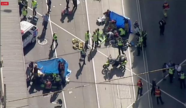 Emergency medical workers offer aid to victims struck by a vehicle (Australian Broadcast Corp. via AP)
