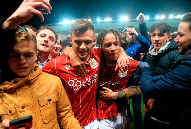 Bristol City's Jamie Paterson (left) and Bobby Reid celebrate their victory over Manchester United Photo: PA