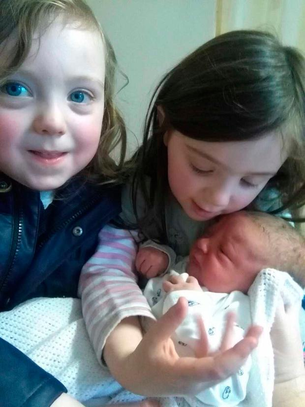 The baby with his older siblings Emily and Dan