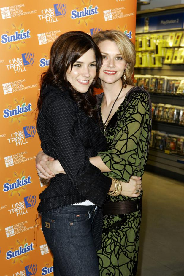 NEW YORK - FEBRUARY 7: (L-R) Actresses Hilarie Burton and Sophia Bush arrive at the midtown FYE store to sign copies of the new