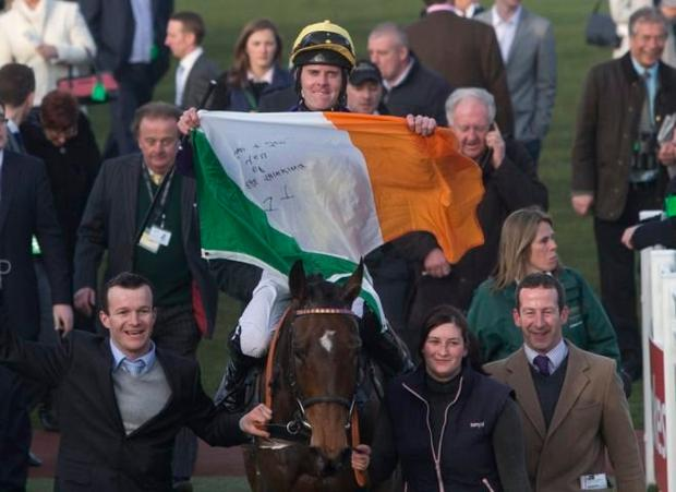 Robbie McNamara celebrates after winning on Spring Heeled on day four of the 2014 Cheltenham Festival. Pic:Mark Condren