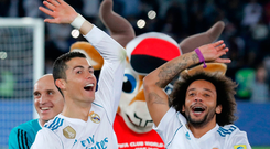 Real Madrid's Cristiano Ronaldo and Marcelo, right, celebrate after winning the Club World Cup final soccer match between Real Madrid and Gremio. Photo: Hassan Ammar/AP