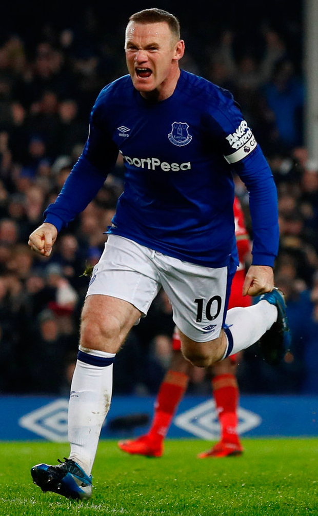 Everton's Wayne Rooney celebrates scoring Everton's third goal against Swansea City on Monday. Photo: Jason Cairnduff/Reuters