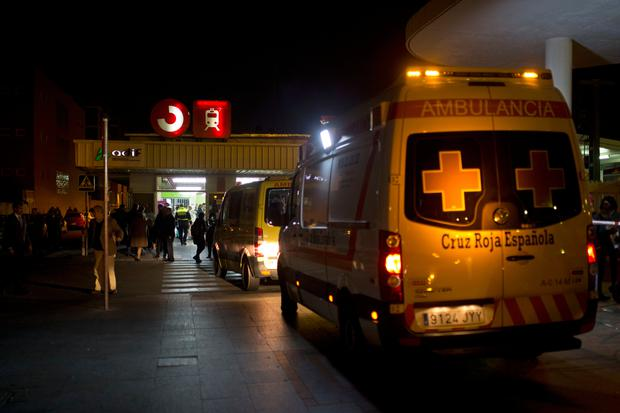 Ambulances wait outside a train station after a train hit the buffers in Alcala de Henares, central Spain, Friday, Dec. 22, 2017. Emergency services in Spain said more than 40 people were treated, four of them for serious injuries, after a double-decker commuter train crashed into a barrier in a town near Madrid on Friday. (AP Photo/Francisco Seco)