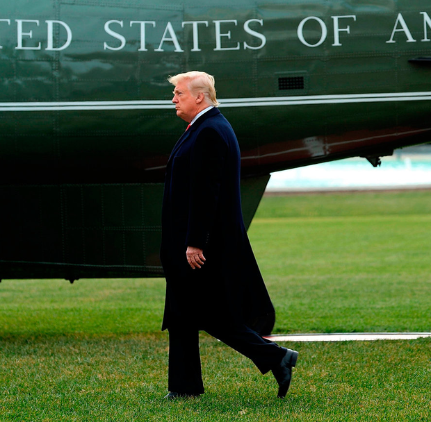 President Donald Trump walks across the South Lawn before boarding Marine One to spend the Christmas holiday at his Mar-a-lago Estate in Palm Beach, Florida. Photo: Chip Somodevilla/Getty Images