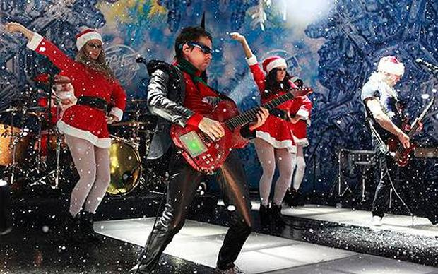 The band Muse get into the swing of things on Christmas 'Top of the Pops'
