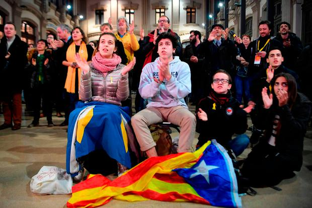 ERC – 'Esquerra Republicana de Catalunya' (or Republican Left of Catalonia) – supporters watch polls results of the Catalan regional election in Barcelona on Thursday. Photo: Getty Images