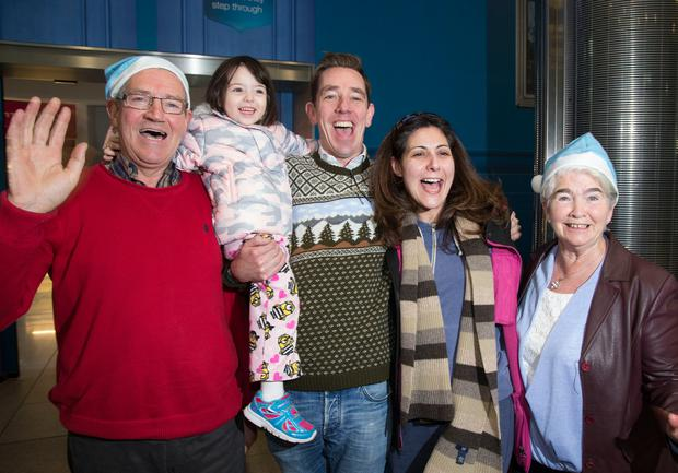 Ryan Tubridy holds up Fiona McEvoy (3), who flew in from New York with her mother Nicole to meet her grandparents Joe and Kathleen for the first time. Photo: Colin O'Riordan