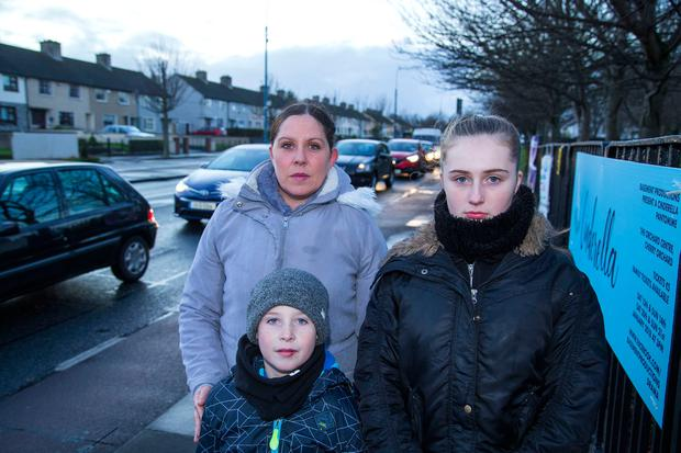 Selina Hogan pictured with her children Scott (9) and Lauren (15) at Ballyfermot. Photo: Colin O'Riordan