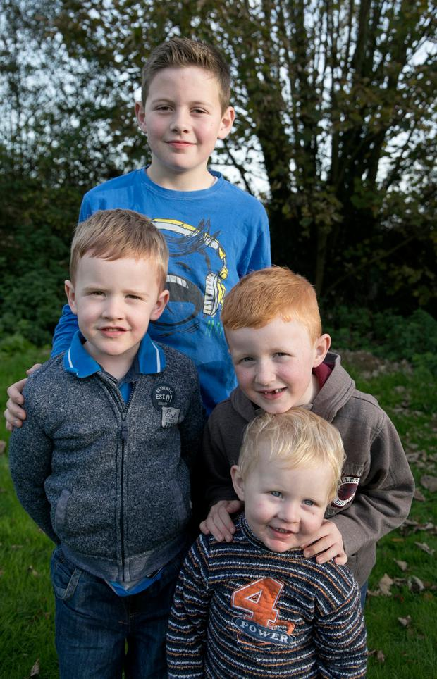 Nathan (11), Leon (7), Bailey (6) and Callum (2) Walsh, who have been left homeless two weeks before Christmas after their logpile caught fire, damaging their house