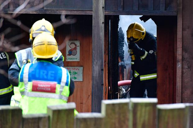 Firefighters at Adventure cafe and shop near the Meerkat enclosure at London Zoo where there was a blaze earlier Saturday Credit: Dominic Lipinski/PA Wire