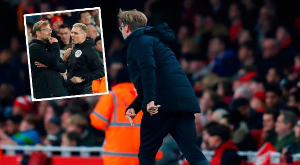 Jurgen Klopp throws a botle in reaction as Roberto Firmino of Liverpool scores their third