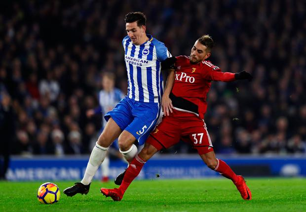 Lewis Dunk of Brighton and Hove Albion is challenged by Roberto Pereyra of Watford. Photo: Getty Images