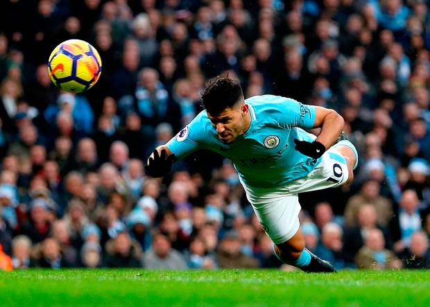 Manchester City's Sergio Aguero opens the scoring during the 4-0 win over Bournemouth yesterday. Photo: Getty Images/Matthew Lewis