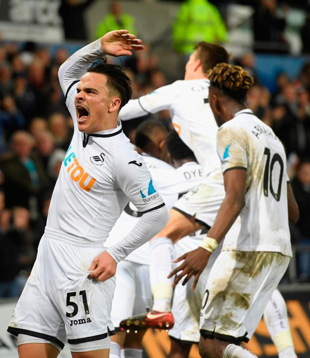 Roque Mesa (l) celebrates the Swansea goal with team mates. Photo: Getty Images