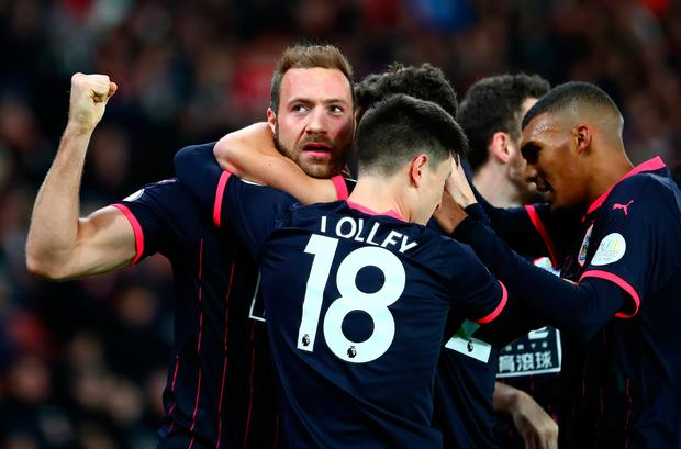 Laurent Depoitre of Huddersfield Town celebrates with teammates after scoring his sides first goal. Photo: Getty Images