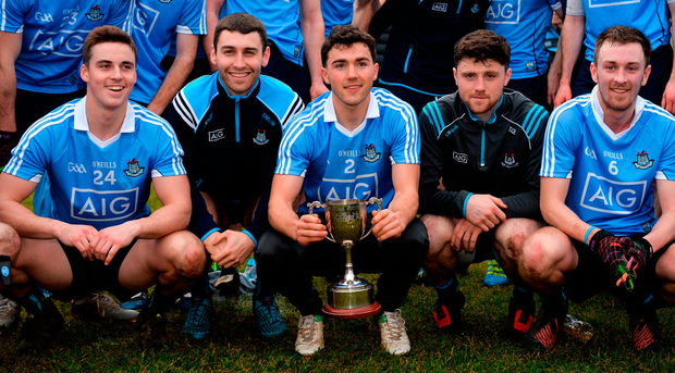 Dublin captain Colm Basquel, centre, and his team-mates with the cup after the Annual Dub Stars Football Challenge match between Dublin and Dub Stars at St Vincent's GAA Club in Dublin. Photo: Piaras Ó Mídheach/Sportsfile