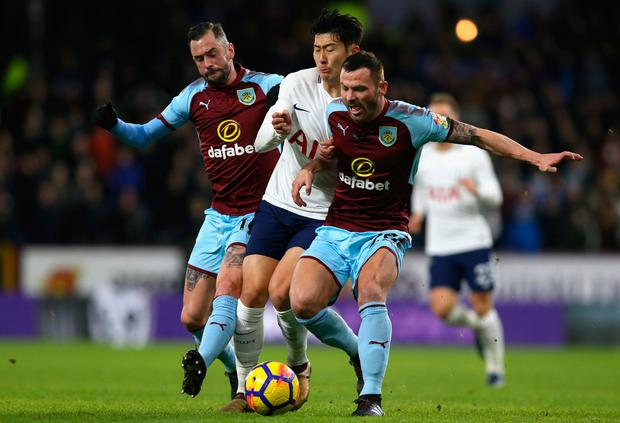 Steven Defour of Burnley and Phil Bardsley of Burnley close down Heung-Min Son of Tottenham. Photo: Getty Images