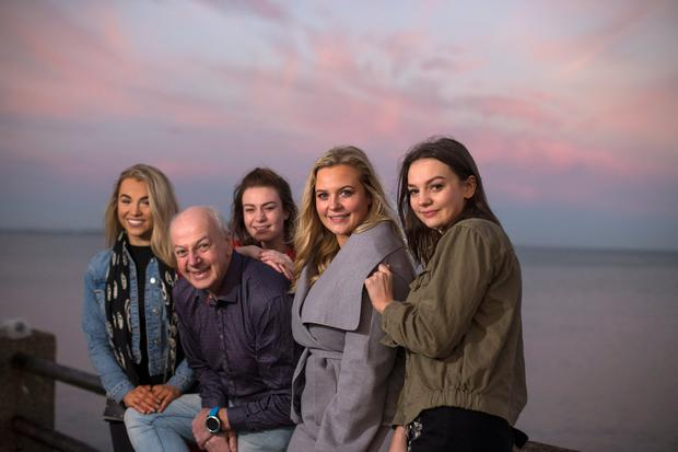 FAMILY MAN: Bobby Kerr (57) with his daughters Michaela (19), Emily (24), Meghan (26), and Rebecca (21). Photo: Mark Condren