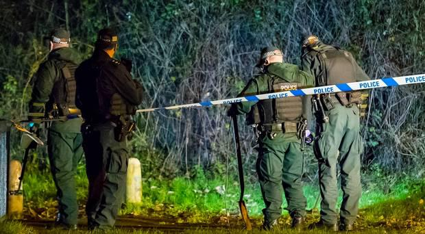 Police officers arrive at the scene of a shooting in the Pembroke Loop road area of Poleglass (Photo by Kevin Scott / Belfast Telegraph)