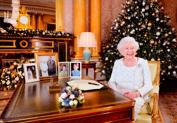 Queen Elizabeth II sits at a desk in the 1844 Room at Buckingham Palace, after recording her Christmas Day broadcast to the Commonwealth at Buckingham Palace, London. (Photo by John Stillwell - WPA Pool/ Getty Images)