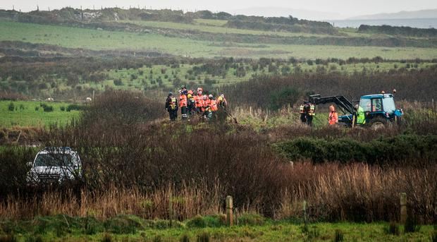 Two people missing after vehicle  entered a river in Mayo