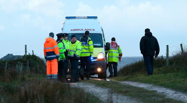 Gardai and member of the Order of Malta near the Carrowniskey area of Louisburgh, Co. Mayo where two bodys were recovered from the sea after an SUV entered the water. Photo: Damien Eagers