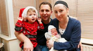 Aoife and John Stewart with daughter Laura and new baby James. Photo: Stephen Collins/Collins Photos