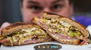 Barry Stephens, the owner of 147 Deli, and his amazing sandwich. Photo: Doug O'Connor