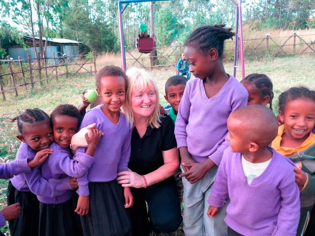 Margaret Anne O'Brien with children from the kindergarten school in the poor rural village of Ambo in Ethiopia