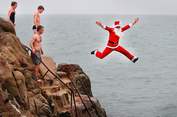 Santa (aka Karl Butler from Citywest) takes the plunge at the Forty Foot in Dublin. Photo: Steve Humphreys