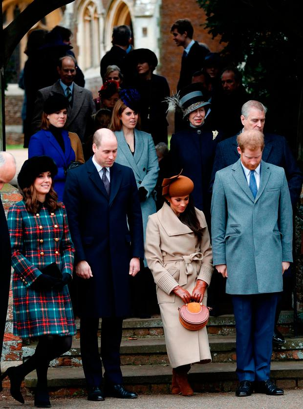 US actress and fiancee of Britain's Prince Harry Meghan Markle (2R) and Britain's Catherine, Duchess of Cambridge, (L) curtsey flanked by Britain's Prince William, Duke of Cambridge (2L), and Britain's Prince Harry (2R) who bow as they see off Britain's Queen Elizabeth II leaving after the Royal Family's traditional Christmas Day church service at St Mary Magdalene Church in Sandringham, Norfolk, eastern England, on December 25, 2017. / AFP PHOTO / Adrian DENNISADRIAN DENNIS/AFP/Getty Images