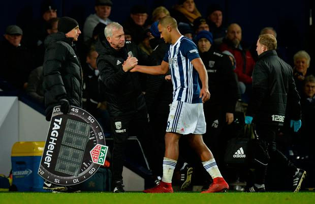 West Bromwich Albion manager Alan Pardew consoles Salomon Rondon as he is substituted after sustaining an injury. Photo: REUTERS/Peter Powell