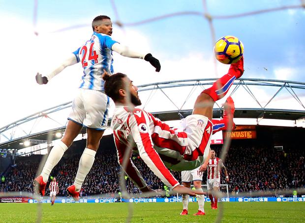 Stoke City's Eric Maxim Choupo-Moting has a shot saved by Huddersfield Town's Jonas Lossl (not pictured). Photo: REUTERS/David Klein