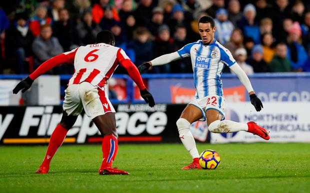 Huddersfield Town's Tom Ince in action with Stoke City's Kurt Zouma. Photo: REUTERS/David Klein